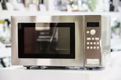 Microwave oven in retail store Stock Photo