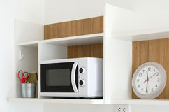 Microwave oven on shelf in pantry. Microwave oven on shelf in modern pantry royalty free stock images