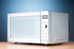 Microwave oven on the table. Microwave oven on the wooden table stock images