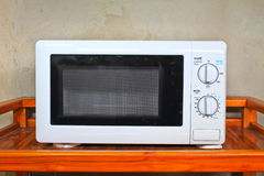 Microwave oven on the table. In kitchen stock photos
