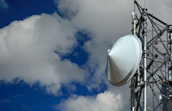 Microwave Radio Tower Dish on a Sunny Clear Day Stock Images