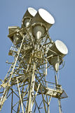 Microwave Telecommunications Tower. Against a clear blue sky Stock Image