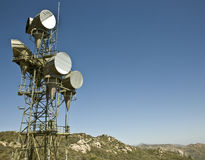 Microwave Telecommunications Tower. At the top of a mountain Royalty Free Stock Images