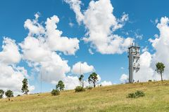 Microwave telecommunications tower on a mountain at Ficksburg. A microwave and other telecommunications towers on a mountain overlooking Ficksburg in the Free Royalty Free Stock Image