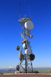 Microwave Tower. A Microwave Tower with flat parabola on a mountaintop Royalty Free Stock Images