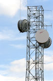 Microwave Tower. Microwave antennas on a communications tower Stock Image