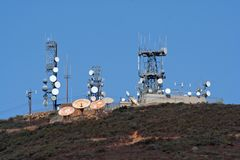 Microwave towers and cell site. S are atop a mountain Royalty Free Stock Photography