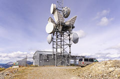 Microwave transmission tower and buildings Stock Photo