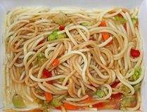 Microwaved meal of noodles, gravy and vegetables Royalty Free Stock Images