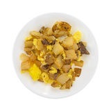 Microwaved potatoes eggs and steak with cheddar cheese breakfast Royalty Free Stock Photo
