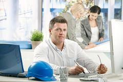 Mid-adult architect working in office Royalty Free Stock Photos