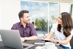Business People Discussing At Table In Shopping Mall stock images