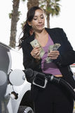Mid Adult Business Woman Counting Money Stock Photography