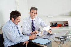 Mid Adult Businessman With Colleague In A Meeting Royalty Free Stock Photos