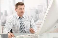 Mid-adult businessman at work Royalty Free Stock Images
