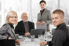 Mid-adult businesspeople sitting at meeting Royalty Free Stock Images