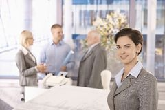 Mid-adult businesswoman in office with colleagues Stock Image