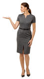 Mid Adult Businesswoman Presenting Invisible Product Stock Photo