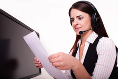 Mid adult businesswoman reading documents at office desk Royalty Free Stock Photos