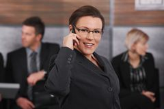 Mid-adult businesswoman talking on mobile stock photo