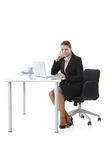 Mid-adult businesswoman working at desk Stock Photo