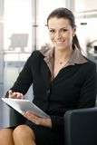 Mid-adult businesswoman working with tablet Stock Image