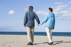 Mid-adult couple on the beach royalty free stock photos