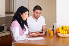 Mid adult couple calculating Stock Image