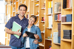 Mid Adult Couple Holding Books In Store Royalty Free Stock Photo