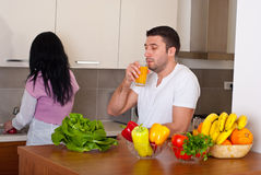 Mid adult couple in kitchen Stock Photo
