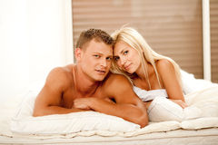 Mid adult couple lying in bed Royalty Free Stock Images