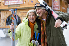 Mid adult couple with snow skis Royalty Free Stock Photo