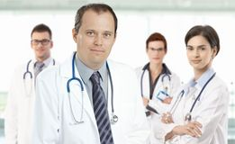 Mid-adult doctor leading medical team Stock Images