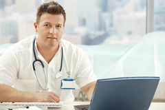 Mid-adult doctor in office Stock Photo