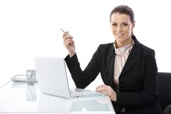 Mid-adult elegant businesswoman at desk Stock Photos