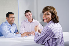 Mid-adult female office worker, in meeting stock photo
