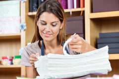 Mid Adult Female Worker Analyzing Papers Stock Photos