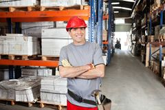 Mid Adult Foreman With Arms Crossed At Warehouse. Portrait of happy mid adult foreman with arms crossed at warehouse Stock Photography