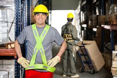 Mid Adult Foreman With Hands On Hips At Warehouse Royalty Free Stock Image