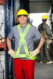 Mid Adult Foreman With Hands On Hips At Warehouse Stock Photo