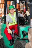 Mid Adult Forklift Driver At Warehouse Royalty Free Stock Photos