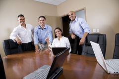 Mid-adult Hispanic office workers in boardroom Royalty Free Stock Photo