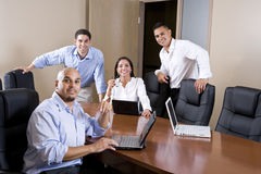 Mid-adult Hispanic office workers in boardroom Stock Image