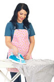 Mid adult housewife ironing Royalty Free Stock Photo