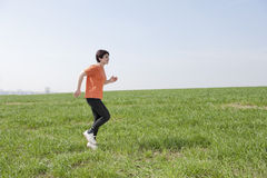 Mid adult jogging woman Stock Photo