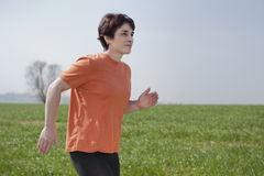 Mid adult jogging woman Royalty Free Stock Photo
