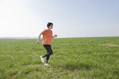 Mid adult jogging woman Royalty Free Stock Image