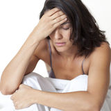 Mid-adult latin woman suffering from headache Royalty Free Stock Photos
