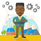 Mid adult male african engineer holding blueprint Royalty Free Stock Images