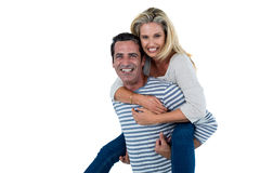 Mid adult man carrying woman piggyback Stock Photo
